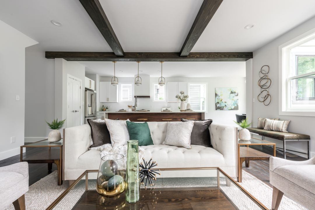 Living room from home staging project on Montgomery Street in Atlanta. Whites and pops of color complete this modern design.