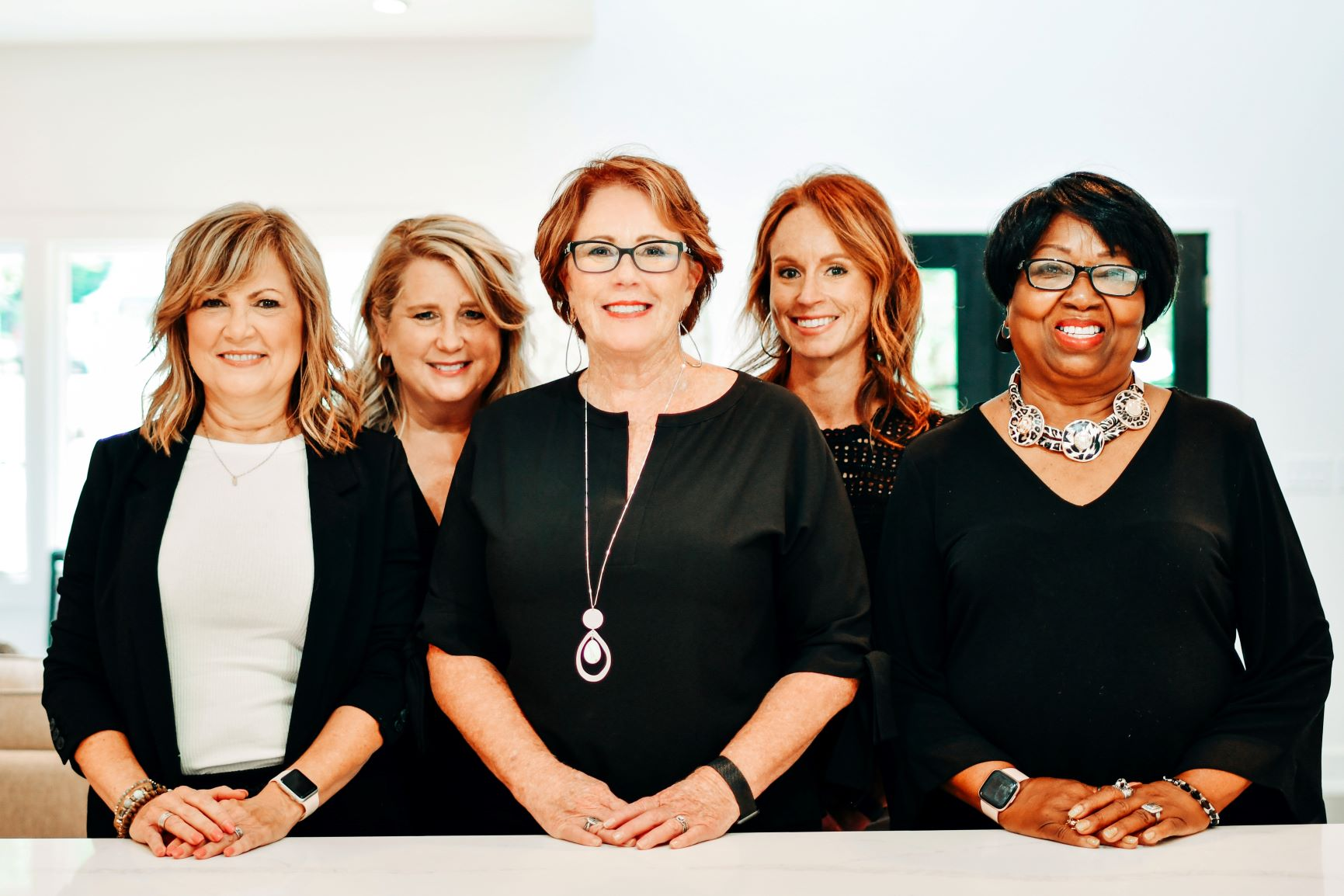 Portrait of Classic Staging, LLC. five home staging team members.